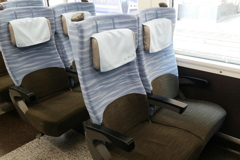 Tokyo to Chureito Pagoda. JR Azusa limited express train reserved seats interior. Backpacking Tokyo Japan