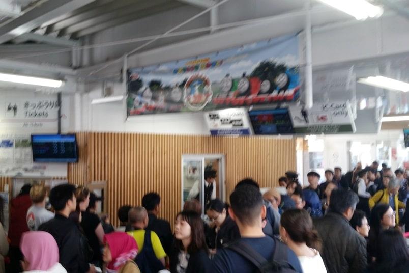 Tokyo to Chureito Pagoda. Otsuki train station, buy tickets to kawaguchiko. Backpacking Tokyo Japan
