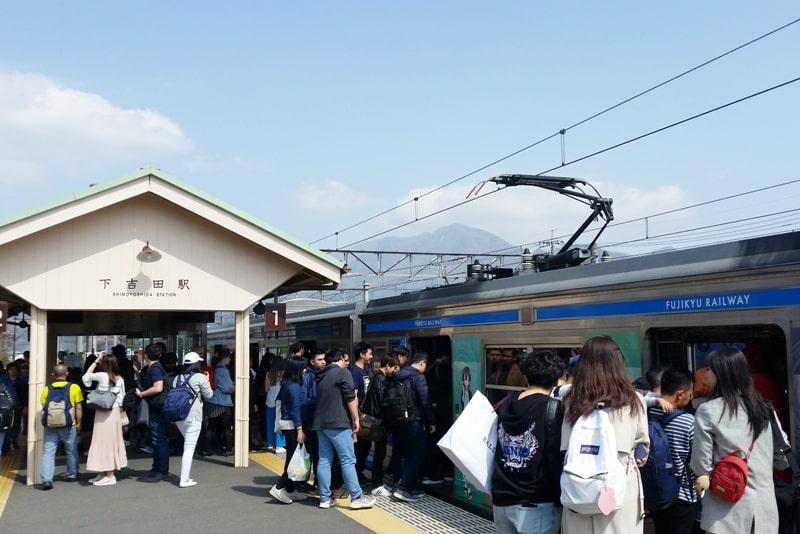 Tokyo to Chureito Pagoda. Fujiyoshida train station fujikyu commuter local train. Backpacking Tokyo Japan