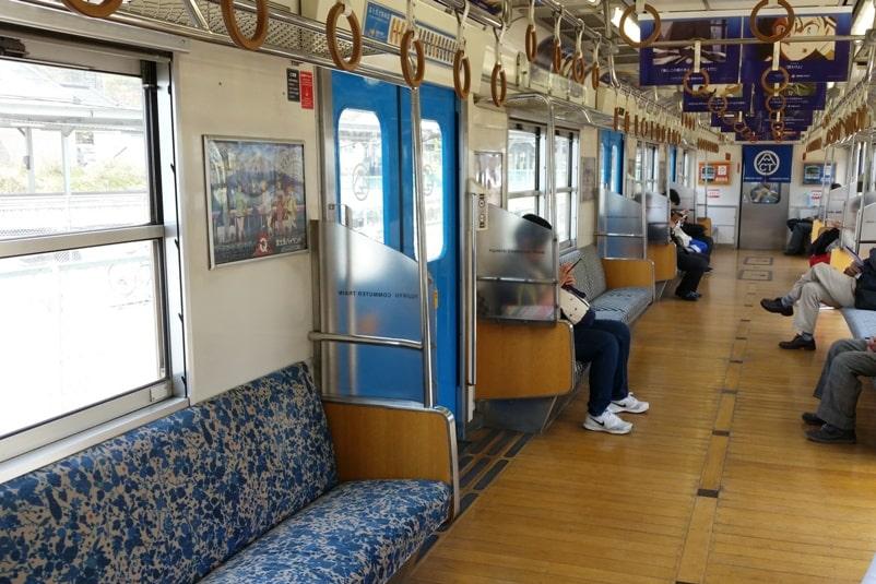 Tokyo to Chureito Pagoda. Otsuki to fujiyoshida to kawaguchiko train fujikyu commuter local train seats interior. Backpacking Tokyo Japan