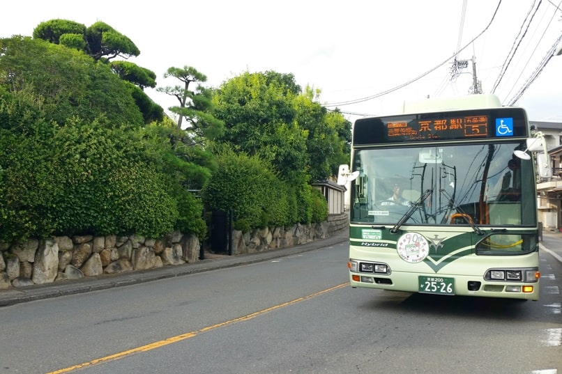 Getting around Kyoto by bus. kyoto city bus green. Backpacking Japan travel blog