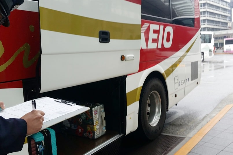 Tokyo to Nagano bus ticket show to driver. Backpacking Japan travel blog