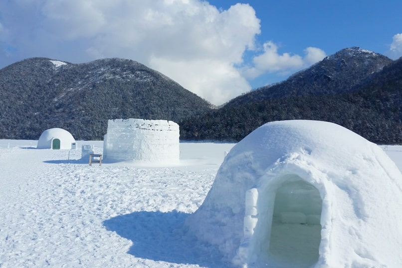 Hokkaido Japan winter itinerary with 7-day JR Hokkaido pass. Lake Shikaribetsu ice village, igloo village. 3 days in Hokkaido. Backpacking Japan winter travel blog