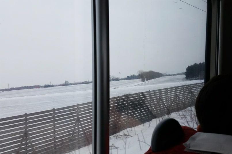 Hokkaido Japan winter itinerary with 7-day JR Hokkaido pass. sapporo to asahikawa train winter snow. day trip possible. 1 day in Hokkaido. Backpacking Japan winter travel blog