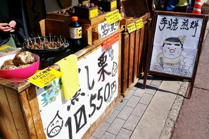 Obuse in Nagano. Japanese street snacks food. hot chestnuts. town street walk. Backpacking Japan travel blog