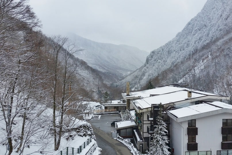 Shinhotaka ropeway in winter. ropeway ride in Japanese alps in bad weather, cloudy weather. Backpacking Japan winter travel blog