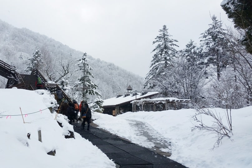 Shinhotaka ropeway in winter. walk to transfer to another ropeway in Japanese alps. Backpacking Japan winter travel blog