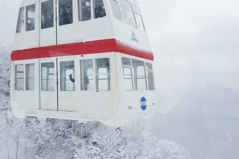 Shinhotaka ropeway in winter weather. Best things to do in Japanese alps in winter in cloudy weather or bad weather. ropeway cable car ride. Day trip from Takayama. Backpacking Japan winter travel blog