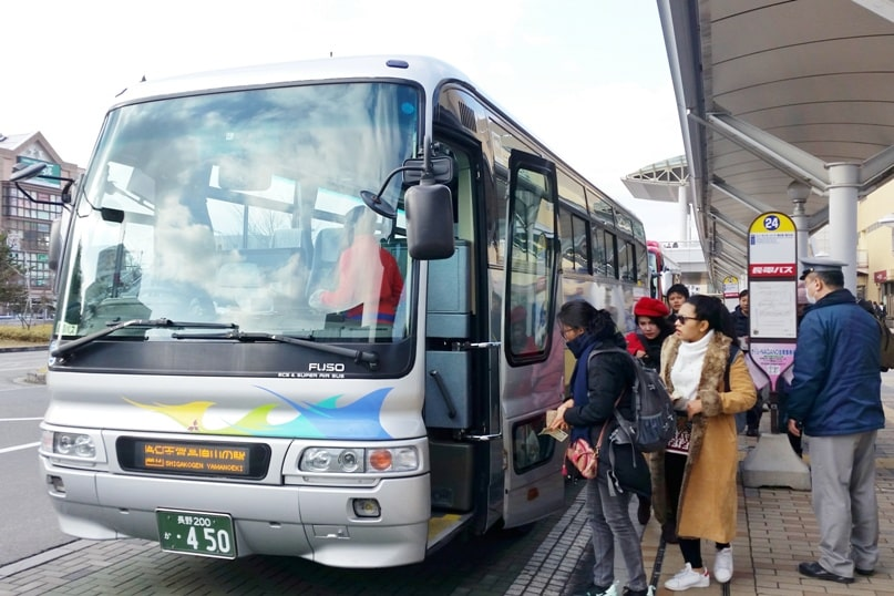 Nagano to Jigokudani monkey park bus ride with snow monkey pass. 2 day Nagano winter itinerary. Backpacking Japan travel blog