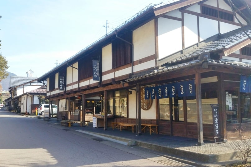 Walk the streets of Obuse chestnut town. 2 day Nagano winter itinerary with snow monkey pass. Backpacking Japan travel blog
